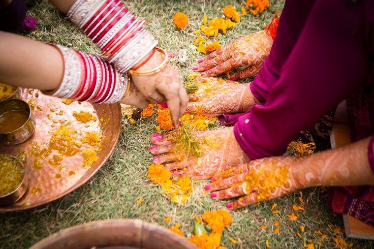 Haldi ceremony at Indian wedding, Delhi summer wedding, bridal red chura, mehendi, indian customs, traditions, candid wedding photography