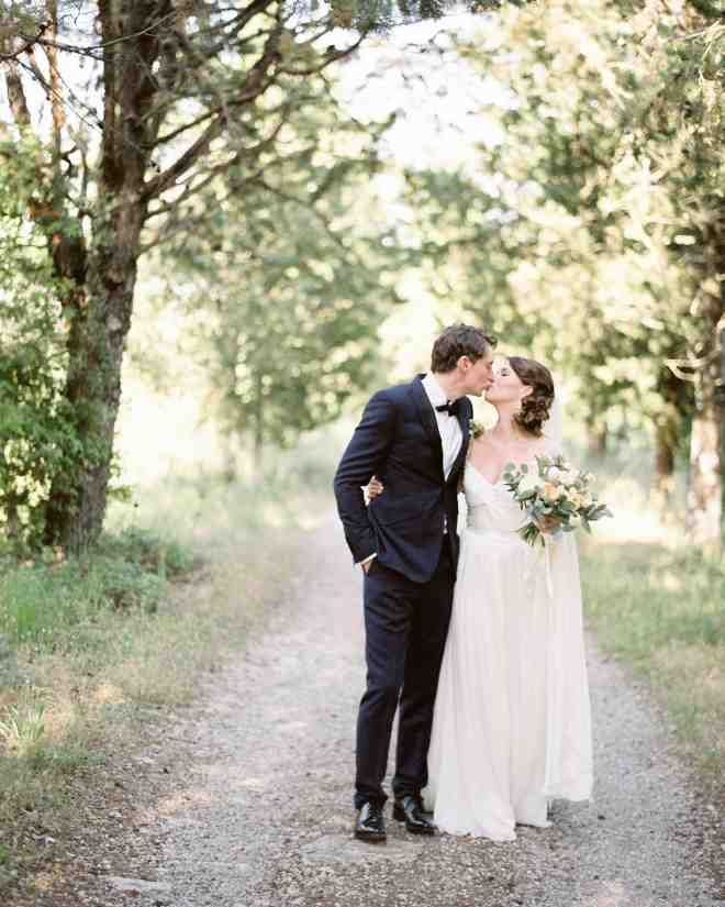"""Ollie donned a midnight blue tux by Ozwald Boateng with a Lanvin bow tie and Church's shoes.Lauren chose a pleated Reem Acra """"Olivia"""" gown, complete with beaded cap sleeves and a knitted bodice. She paired her dress with Jimmy Choo shoes and a Vera Wang veil that she borrowed from a friend."""