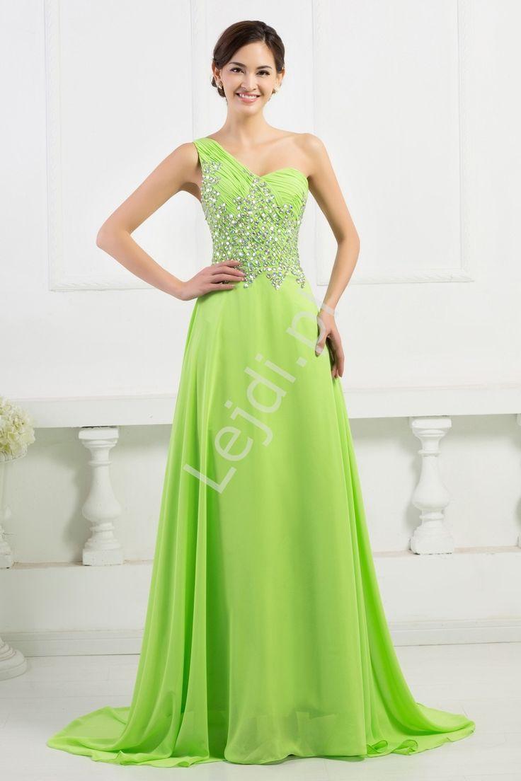 Wieczorowa limonkowa sukienka na jedno ramię, bogato zdobiona kryształkami. Sukienka ze zwiewnego szyfonu, pięknie układająca się z małym trenem. Plecy sukienki wykonane z  przezroczystej siateczki obszytej kryształkami.  Dół szyfonowy z podszewka. Sukienka zapinana na zamek.  Suknia idealna dla świadkowej, dla druhen, na wesele czy na studniówkę.