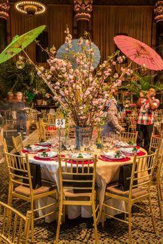 Kim Seybert's Fuchsia Round Bamboo placemats, Green Korean Dragon napkins and Pagoda napkin rings at Byron C. James-Rodrigues's Cherry Blossom Jubilee table.