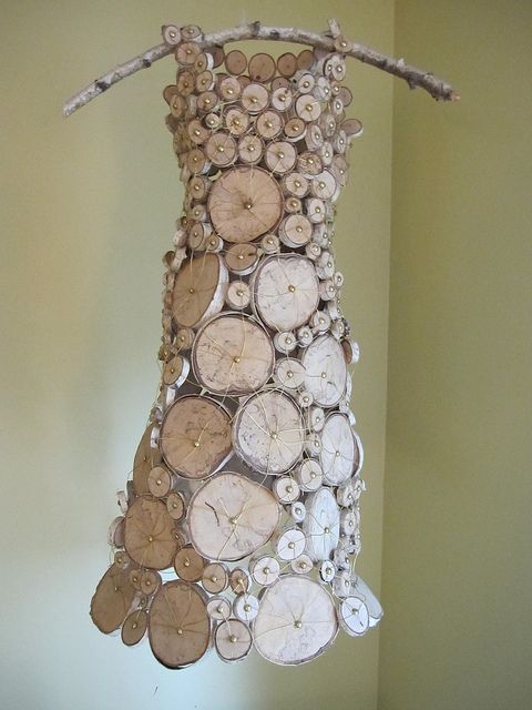 """Birch dress by Tracy Broback - """" I used disks I cut from birch wood I salvaged from my brother's fallen tree. I wired everything together to make this dress."""""""