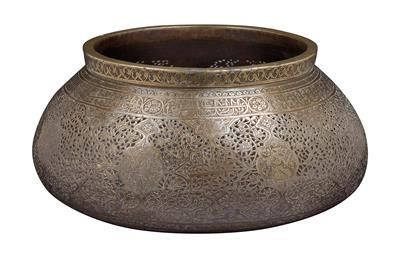 Persia: A round, richly decorated, openwork brass vessel.