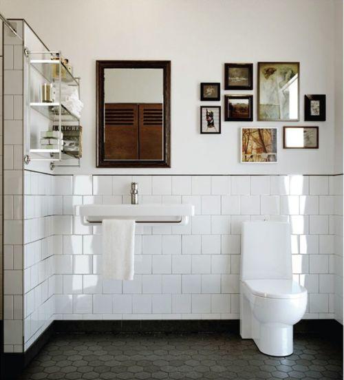 demi-wall of white gloss ceramic tiles.
