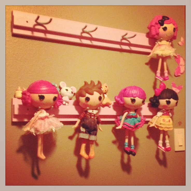Pinterest inspired Lalaloopsy display for my daughter. A crafty creation by mom and dad. Found a cute idea here on Pinterest. Modified the plan to create a better way to cradle the doll heads on the tool hook by adding an extra piece of wood. The large doll heads lay nicely against the board. Works well for littles as well.