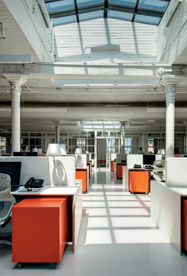 Pops of energetic orange are used throughout tying each of the separate zones together and providing spicinessin the mostly white space of this office.