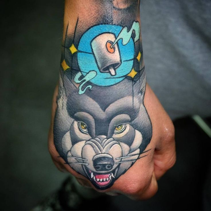 New school wolf tattoo on the right hand animal tattoos for Animal hand tattoos
