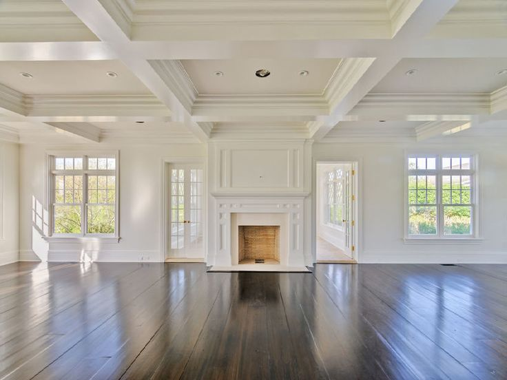 coiffered ceilings. dark hardwood floor. fireplace.