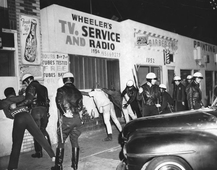 Search for weapons, Watts Riots, 1966, Cliff Wesselman. Black and white photographic print.