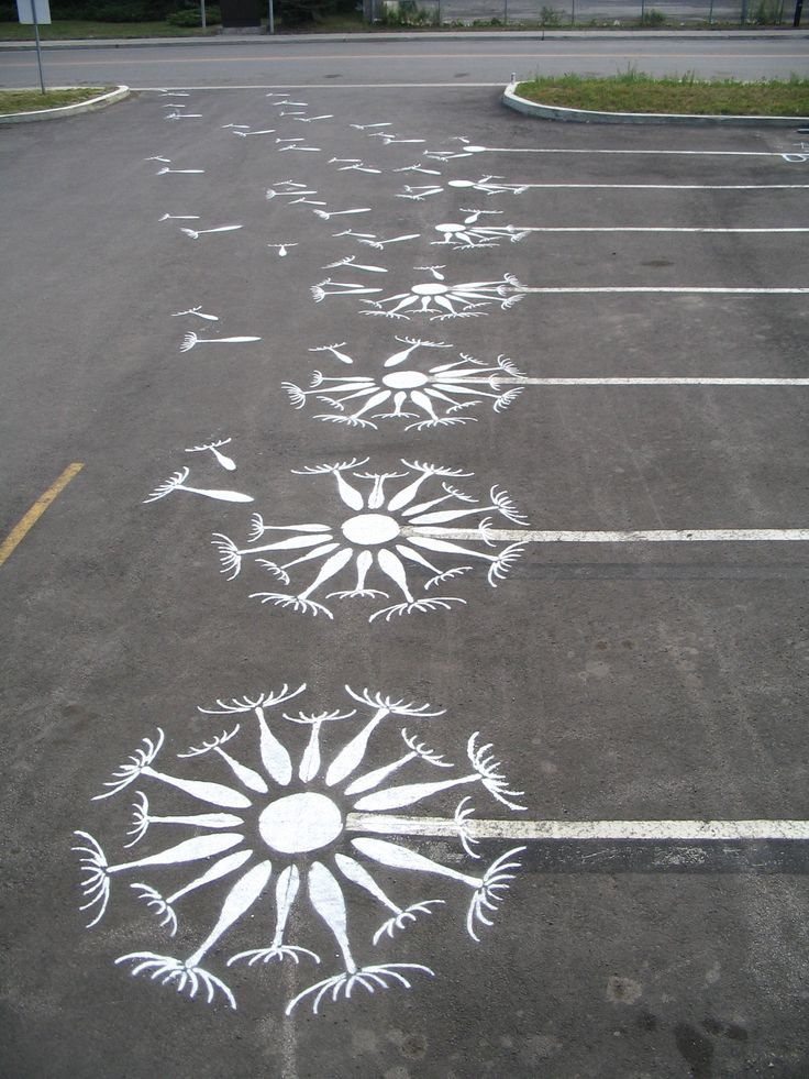 diy & go #graffiti a parking lot, wind blowing dandelion seeds into the air - this is incredibly neat.