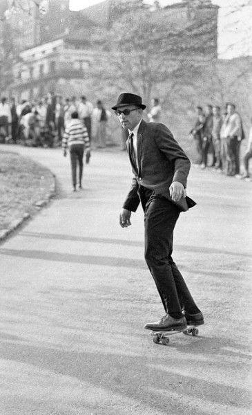 skateboarding in a suit.