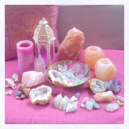 Pink healing altar with crystals and Himalayan salt.