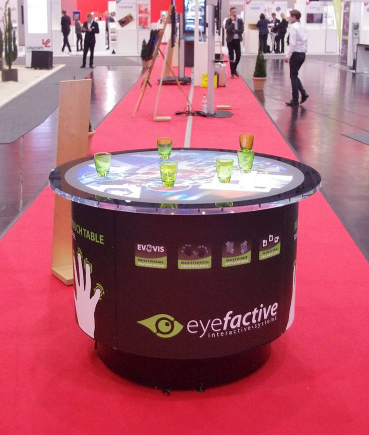 eyefactive presents awarded interactive solutions at viscom 2015. Round multitouch table AURORA with object recognition.