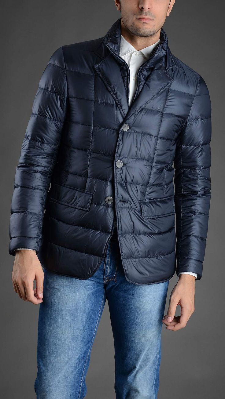 Down quilted jacket with removable zipped inner rib, two pockets, button fastening. 100% polyammide.
