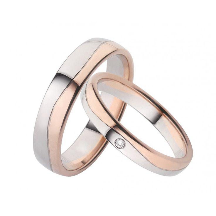 Moderne und elegante Trauringe aus Weiß- und Roségold. Die Ringe sind hochglänzend poliert. Eine wellenförmige umlaufende Fuge, teilt diese besonderen Ringe in zwei Hälften.