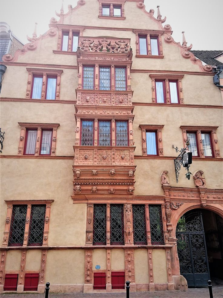 One-hundred-heads house, Colmar, France.  Hundred different heads staring from the walls.