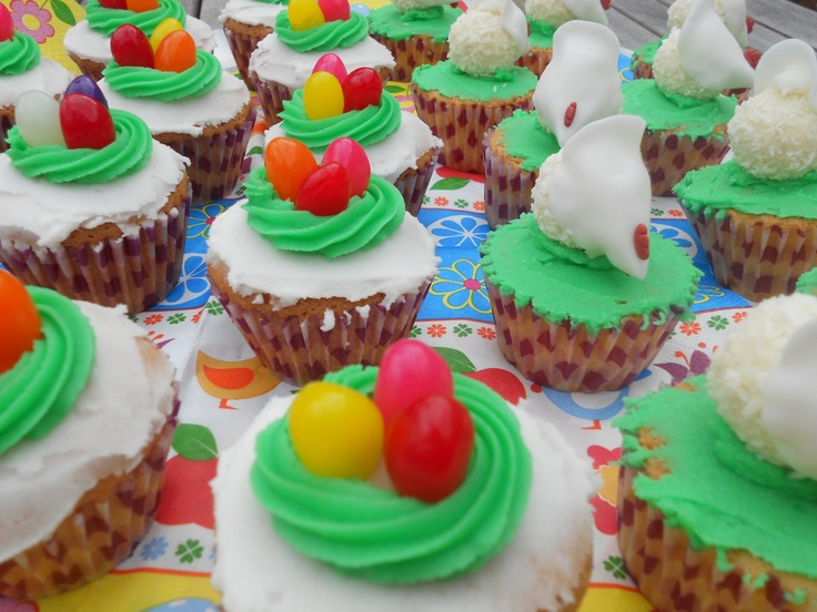 Colourfull easter cupcakes. Chicken is made with a ball-shaped white chocolate and a round shaped piece of fondant. Beak is a little piece of red fondant. Enjoy... www.taart-deco.nl