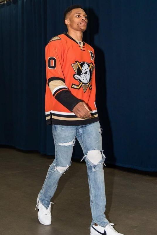 Russell Westbrook wearing Fear of God Selvedge Denim Vintage Indigo Jeans and Reebok Anaheim Ducks Orange Alternate Premier Jersey