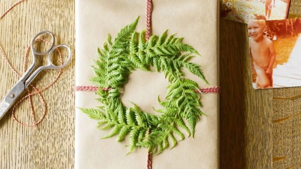 Greenery snipped from the garden and slipped beneath string or ribbon offers an on-trend botanical wrapping option.