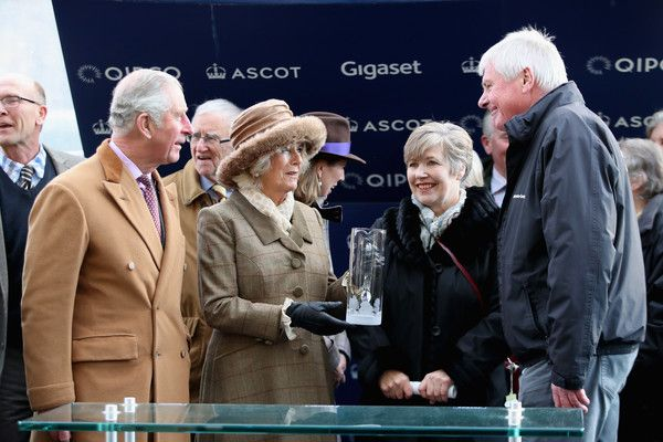Camilla Parker Bowles Photos - Prince Charles, Prince of Wales (L) and Camilla, Duchess of Cornwall (2ndL) present the award for The Waitrose Handicap Steeple Chase to The George Inn Racing Syndicate as they attend the Prince's Countryside Fund Raceday at Ascot Racecourse on November 24, 2017 in Ascot, England. - The Prince of Wales and Duchess of Cornwall Attend The Prince's Countryside Fund Raceday