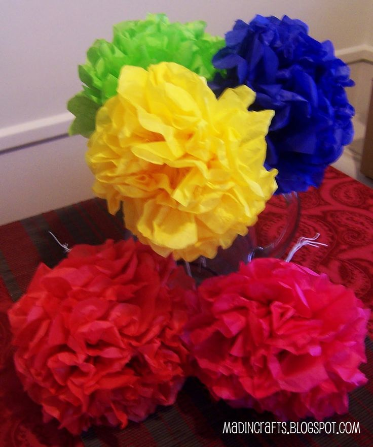 Remember making these in grade school? Today, Mexican paper flowers make a great decor and are a fun, inexpensive, centerpiece option. Learn how to make them here: http://www.madincrafts.com/2009/11/mexican-paper-flowers.html