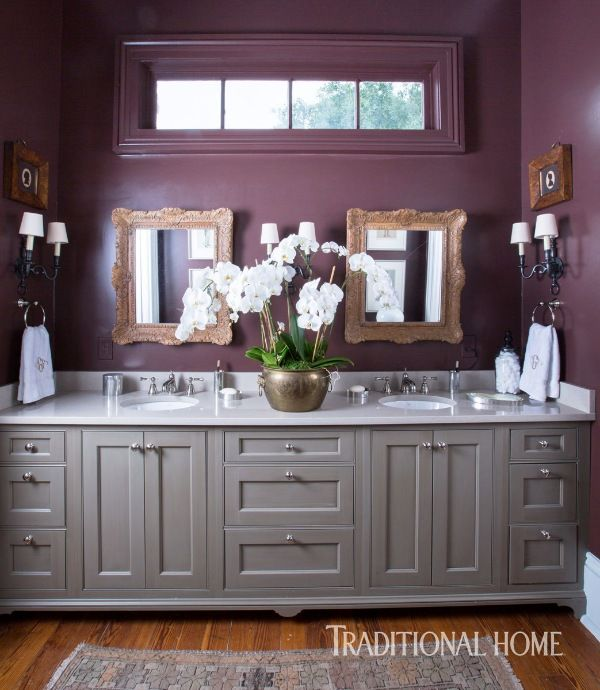 An aubergine hue pops on the walls of this updated turn-of-the-century master bath. - Photo: Brittany Ambridge / Design: Chad Graci & Christina Graci Javanmardi