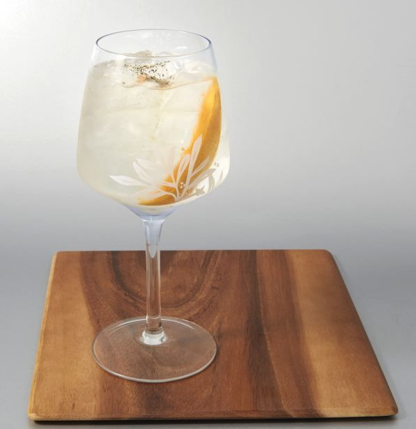 Chemically the best gin and tonic is garnished with mango and black pepper served in a balloon glass to intensify the smell and taste.