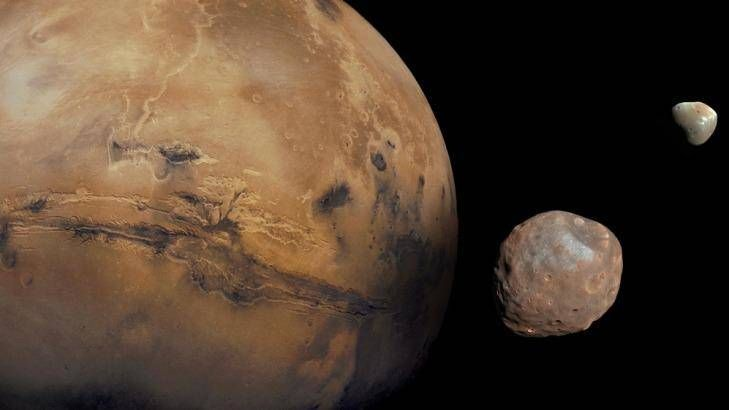 A representation of Mars with its small moons, Deimos and Phobos. Photo: NASA