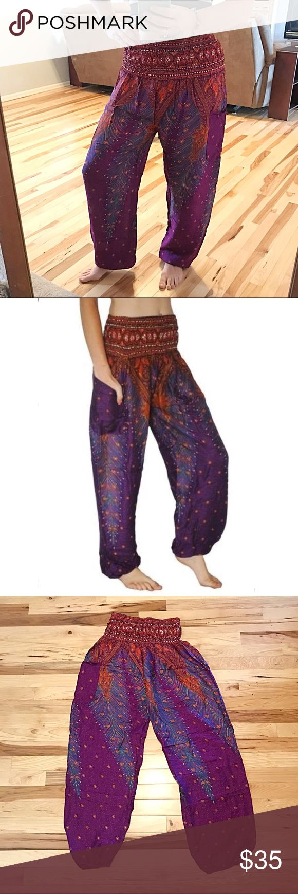 Hippie Boho Harem Pants Purple Festival Yoga Hippie Boho Harem Pants Purple Burnt Orange Festival Yoga Wise leg Pants. Wide elastic band. Waist unstretched is 12 inches stretched is 16 inches inseam is 27 inches and length from top of waist to bottom hem measures 42 inches. One size fits most. Fits Small Medium Large and XL. New in package. Pants Wide Leg
