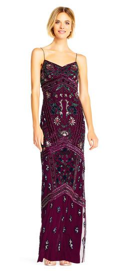 Multicolor blooms abound on this fitted formal dress with a bold mixing of sequins and beading. This gown features a v-neckline, spaghetti straps, and an empire waist, and a slit at the back of the skirt. A zip up back closure completes the design. Paired with a nude heel, this bohemian beaded dress is a sight to behold.