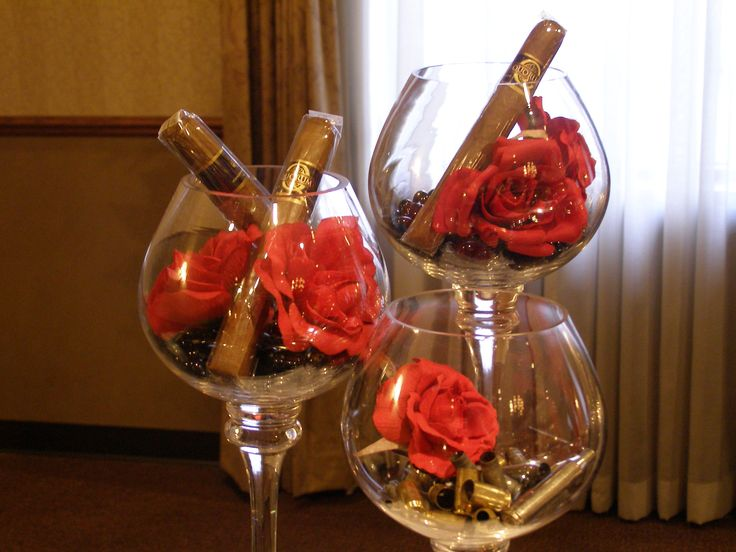 Godfather themed centerpieces. Black gems, red roses and cigars!