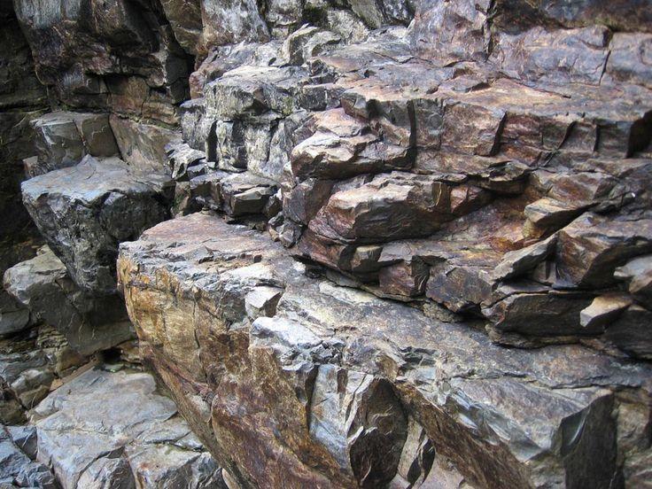 The rocky side of a mountain creek near Orosí, Costa Rica. (presumably metamorphic rocks)