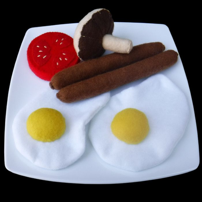 Felt breakfast sausages eggs mushroom and tomato slice