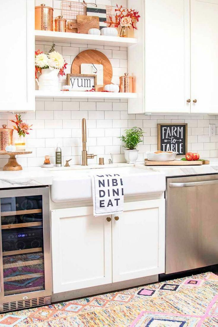 Modern Farmhouse White Kitchen With Copper Accents Style Your Open Shelves For Fall With Breadboards Copper Kitchen Decor White Modern Kitchen Modern Kitchen