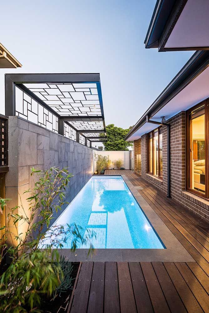 Another Pool Built On The Side Of The House Despite Being Narrow The Pool Is Swimming Pool Landscaping Backyard Pool Swimming Pool Designs