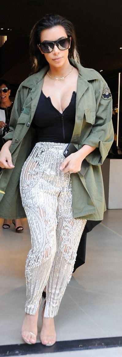 Kim Kardashian: Sunglasses – Givenchy  Pants – Balmain  Shoes – Yeezy