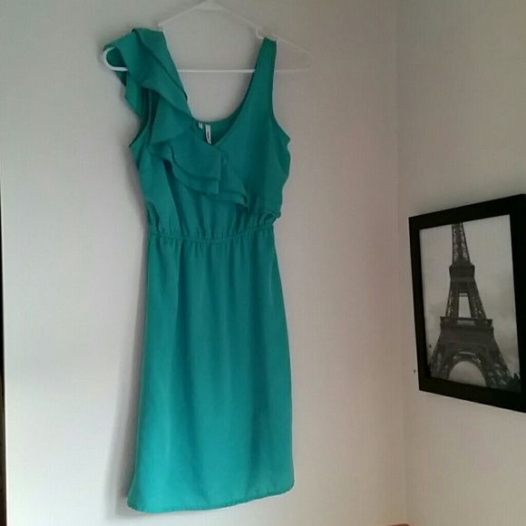 Beautiful Teal Dress This dress reminds me of a tea party. Beautiful and elegant this has a lovely teal color with a ruffle that delicately drapes over the one shoulder. A skinny gold belt and flats would complete this outfit Maurices Dresses