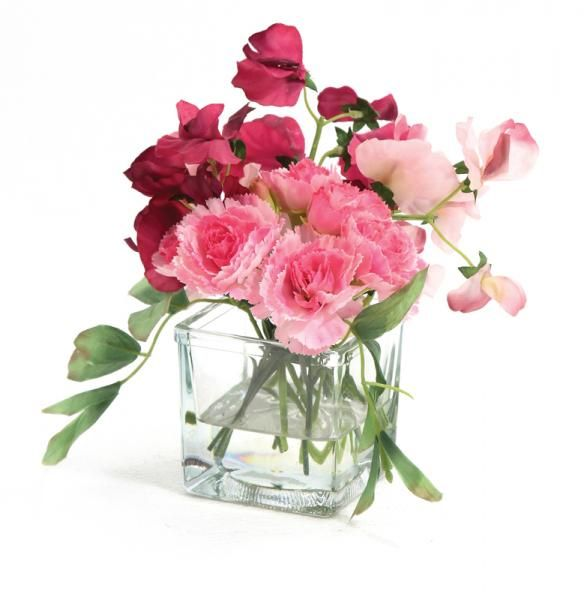 Carnations and Sweet Peas in a small glass cube, set in Still Water™. Pink. Height 15cm. €19.50