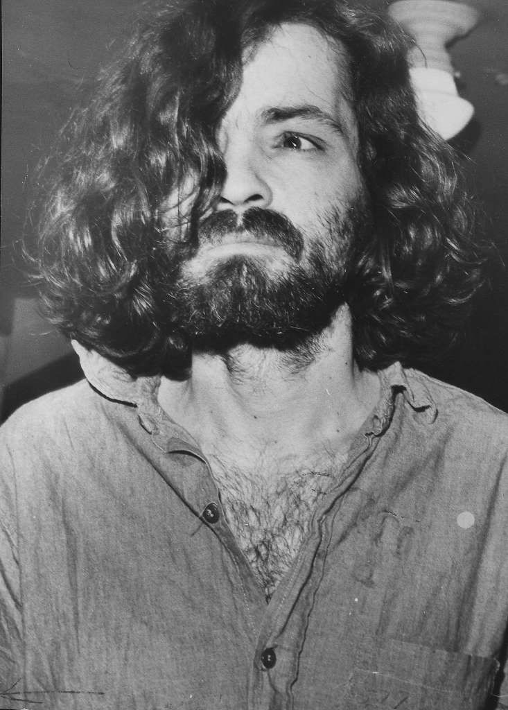 "TAKE A LOOK AT THIS, DENNIS. According to Beach Boys collaborator Van Dyke Parks, ""One day, Charles Manson brought a bullet out and showed it to Dennis."" ... MORE(Above. Charles Manson on his way to court in 1970.) Photo: Los Angeles Times, LA Times Via Getty Images"