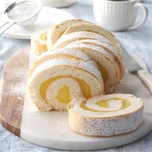 Moist Lemon Angel Cake Roll Recipe -Tart and delicious, this pretty cake roll will tickle any lemon lover's fancy. Its feathery, angel food texture enhances its guilt-free goodness. —Taste of Home Test Kitchen