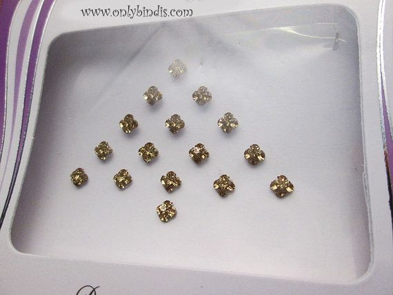 Small golden crystal bindis...Hey, I found this really awesome Bindi listing at http://www.onlybindis.com/shop/