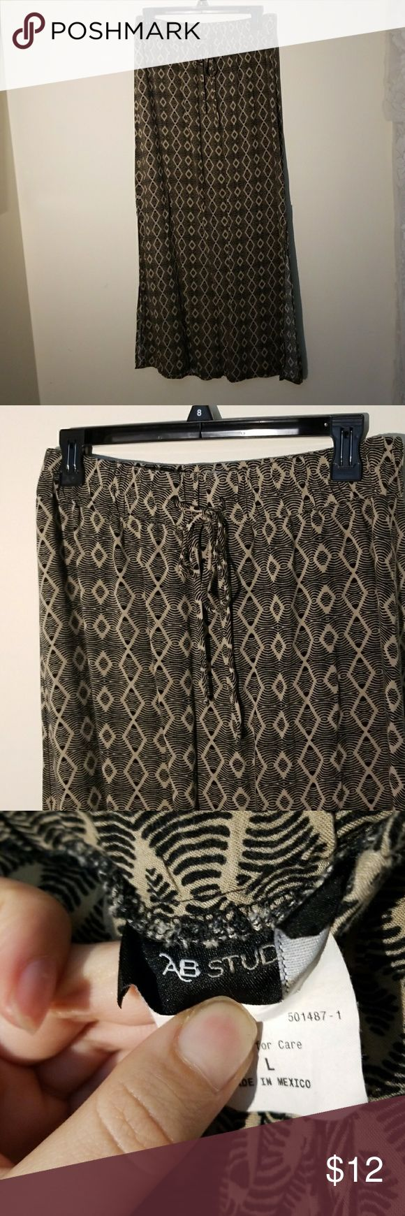 Boho Maxi Skirt Gorgeous and comfy maxi skirt. Has slit on both sides that come to just below the knee. Has a stretchy waist band and thin tie closure. Fits large to medium. Just a little short for me. AB Studio Skirts Maxi