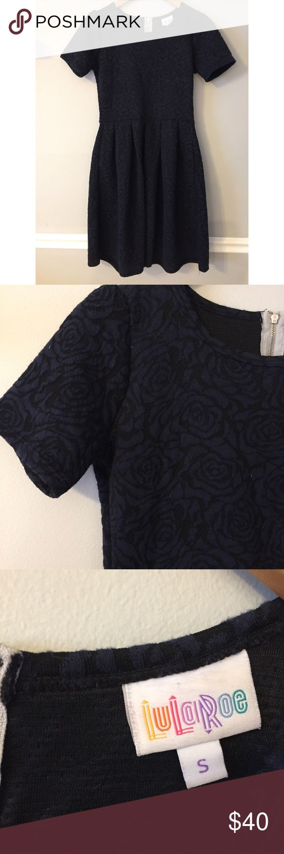 """LuLaRoe • Raised Floral Print Amelia Dress LuLaRoe • Raised Floral Print Amelia Dress  The Amelia Dress stretchy knit fabric is comfortable enough to let you wear the dress all day, while having the structure and tailoring that make it sophisticated enough for the office or a fancy night out.   Excellent preowned condition.  Underarm Span: 17"""" Length: 41"""" to longest hemline. LuLaRoe Dresses"""