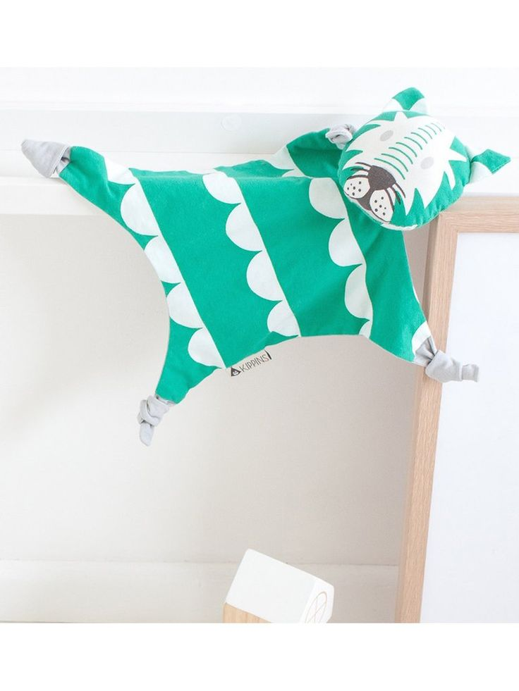 Introducing the King of the cool, and the King of our tribe of Kippins baby comforters - Dash.   He's a wanderer and an adventurer. He's the jewel of the jungle.   Mint green and white scalloped bunting print covers this baby comforter. He's a tiger baby comforter with a soft grey back.  All Kippins baby comforters are designed using simple and bold prints which appeal to babies. They're all hypoallergenic and gentle on new skin. They are perfect for the littlest of little ones!