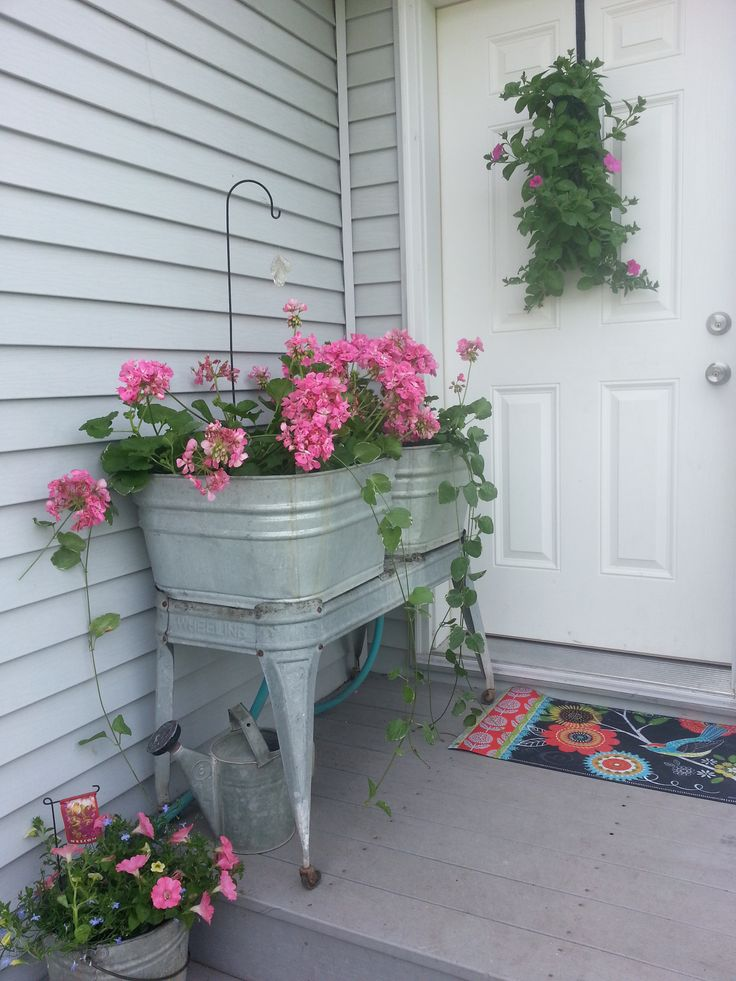 My front porch decorated with vintage wash tubs and galvanized buckets of flowers.