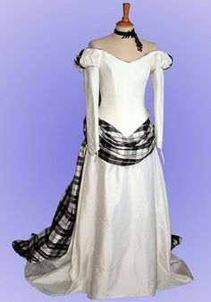 I <3 this dress.  I would probably scale back the tartan a bit...even the way it is, it is lovely :)