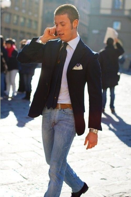 Men's Navy Blazer, White Pocket Square, Navy Tie, Brown Leather Belt, Blue Jeans, and White Vertical Striped Dress Shirt
