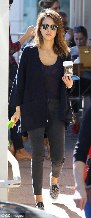 Casual and comfortable: The 34-year-old actress was dressed down in a navy cardigan and gr...