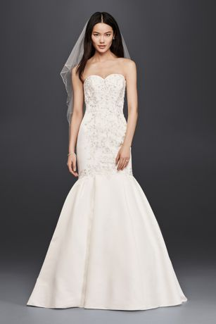 Designed to spotlight your beautiful curves, this mermaid wedding dress combines a richly detailed fitted bodice featuring lace appliques down the center with a skirt that puts some serious flare in your step.  David's Bridal Collection  Polyester  Chapel train  Back zipper; fully lined  Dry clean  Imported  Also available in Plus Size, Petite, Extra Length and Plus Size Extra Length