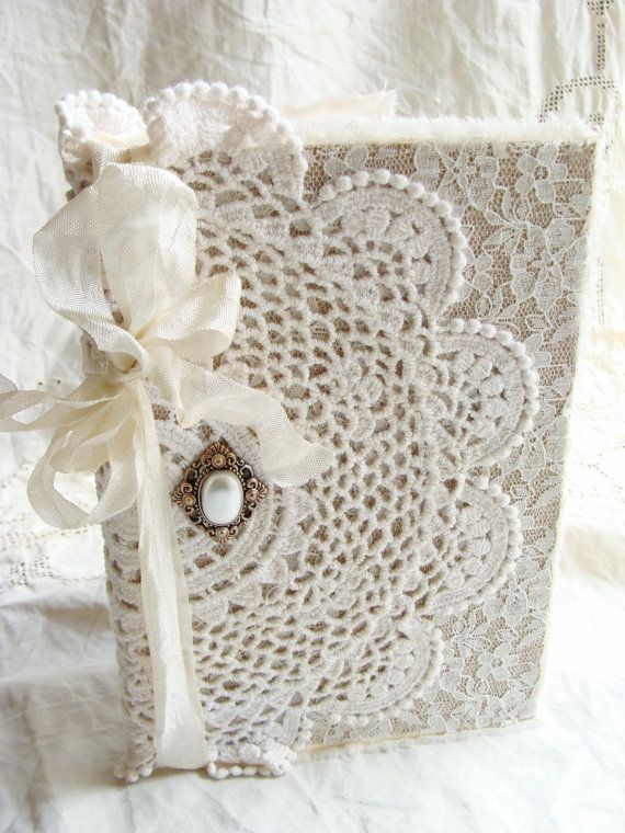 Soft and sweet vintage inspired altered hardback book - covered with layers of fabric, lace and a vintage doily. Adorned with a vintage inspired