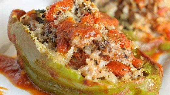 Stuff green bell peppers with a mixture of rice, ground beef and pork sausage for a simple and satisfying supper.